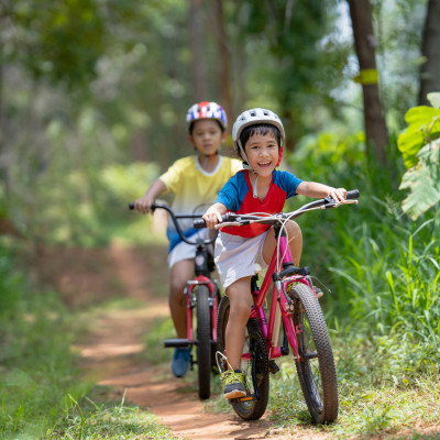 Asian Children Are Happy Mountain Biking